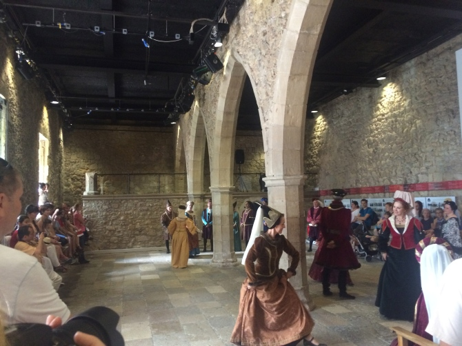 People in costumes dancing to medieval music